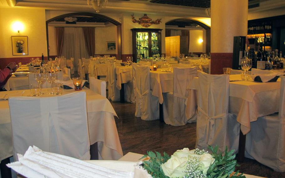 The main dining room at Antica Trattoria Moreieta.