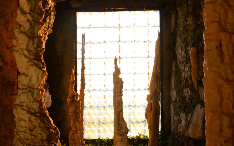 Stalagmites and stalactites decorate a room at the Fortress of Monfalcone, in Italy.