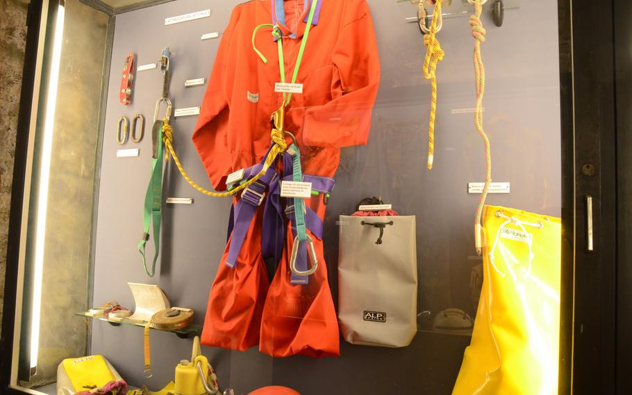 Clothing and equipment used by those exploring the caves around Monfalcone, Italy, are displayed at the Fortress of Monfalcone, in Italy.