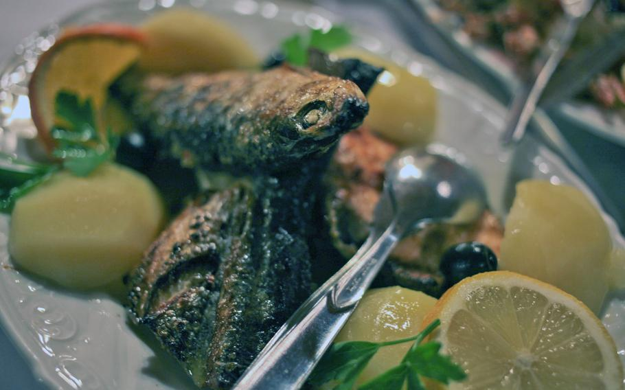 The mixed grilled fish platter with salt potatoes swim in a shallow pool of butter at Lissabon, which specializes in seafood.