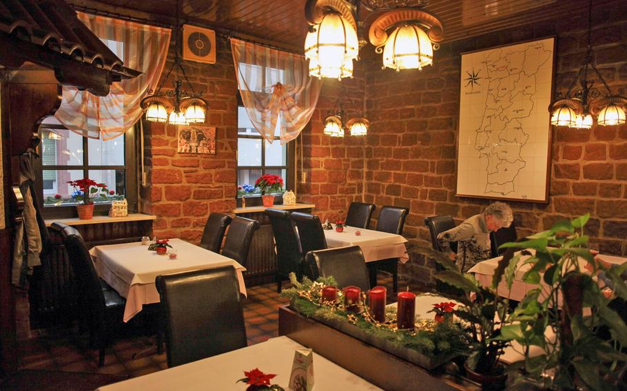 The interior of Lissabon, a Portuguese restaurant in Kaiserslautern, Germany, is warm and inviting.