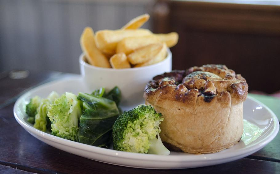 The braised-beef pie at The Architect restaurant in Cambridge, England, comes with thick-cut chips on the side.  The Architect offers pub classic entrees and meats from a spit.
