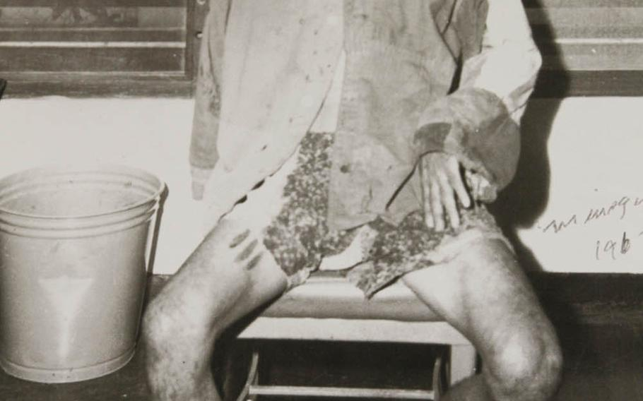 Pvt. Bunzo Minagawa sits in his tattered clothes after being captured in 1960 on Guam after hiding out in the jungle since the end of World War II, in this undated photograph displayed at the Pacfic War Museum, Guam.