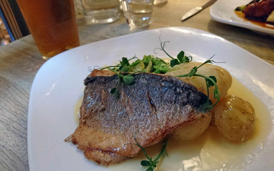 Grilled sea bream with potatoes and greens is one of the dishes served at The One Bull. Dinner for two can range from 30 to 50 pounds.