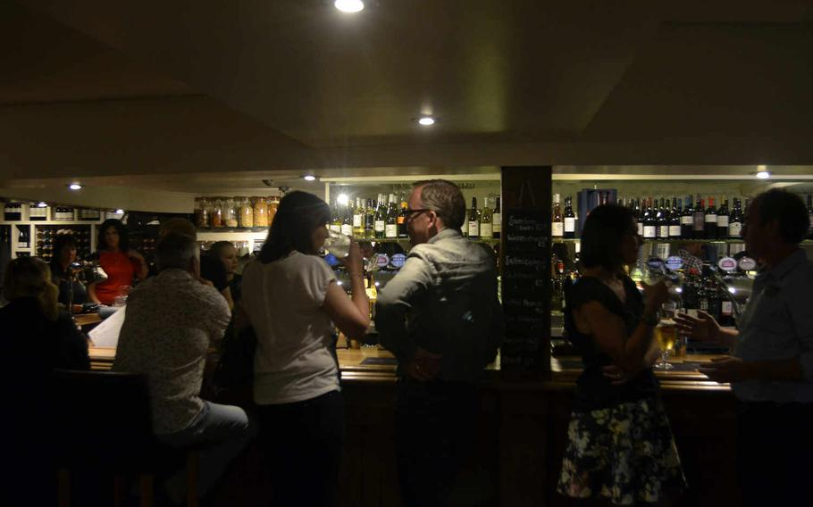 A typical Saturday night at The One Bull in Bury St. Edmunds, England. The rustic-chic restaurant offers a full bar, lounging areas with sofas and a dining area.