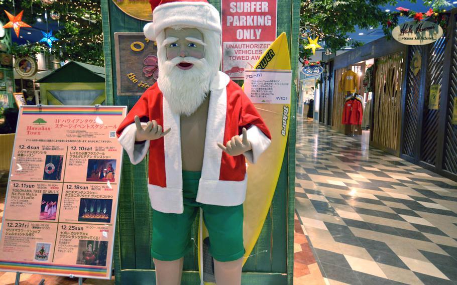 Hawaii Town in Yokohama, Japan, celebrates Christmas with a surfer-style Santa Claus.