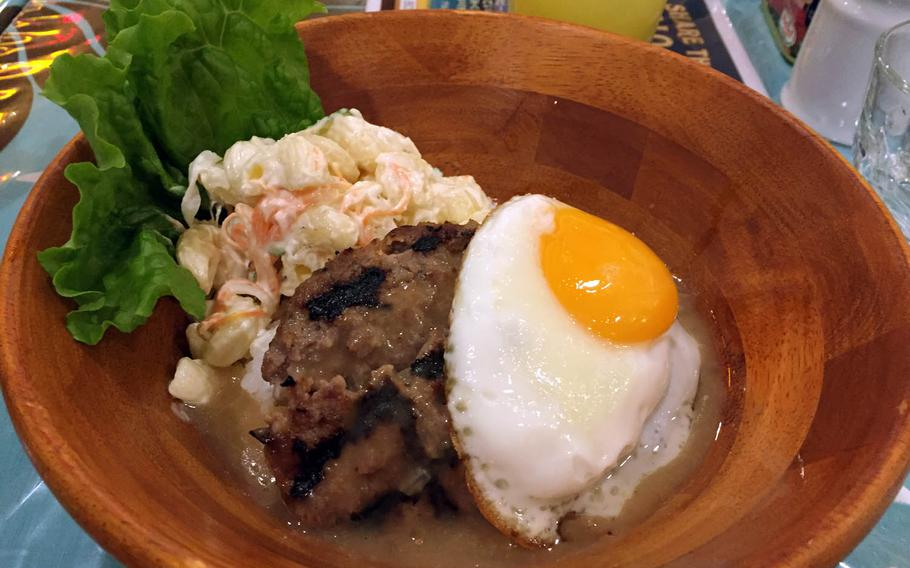 Loco Moco from Halenohea Hawaiian Caf?? and Diner at Hawaii Town in Yokohama, Japan. The dish generally consists of white rice topped with a hamburger patty, a fried egg and brown gravy.