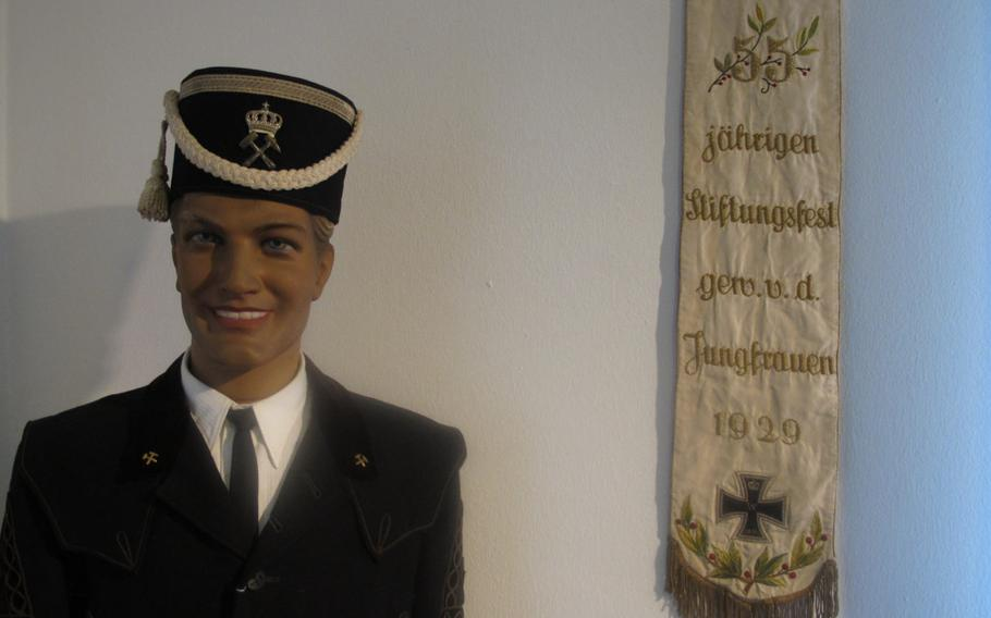 A mannequin wearing an old miner's uniform is displayed in Museum im Westrich in Ramstein, Germany. The museum houses artifacts detailing the daily life on the town's residents in recent history.