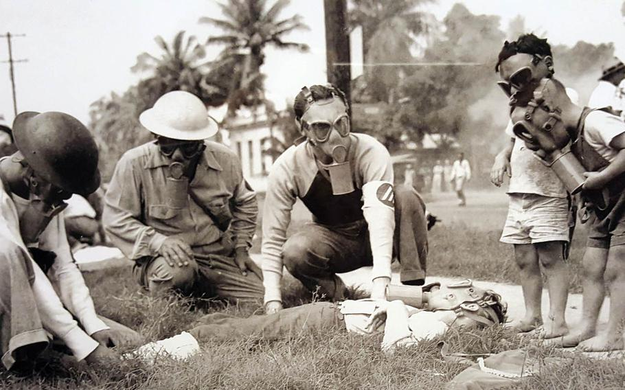 Volunteers conduct a poison-gas drill in Honolulu in this undated photo on display at the Bishop Museum in Honolulu. Everyone over age 7 in Hawaii was issued a gas mask after the Dec. 7, 1941, surprise attack.