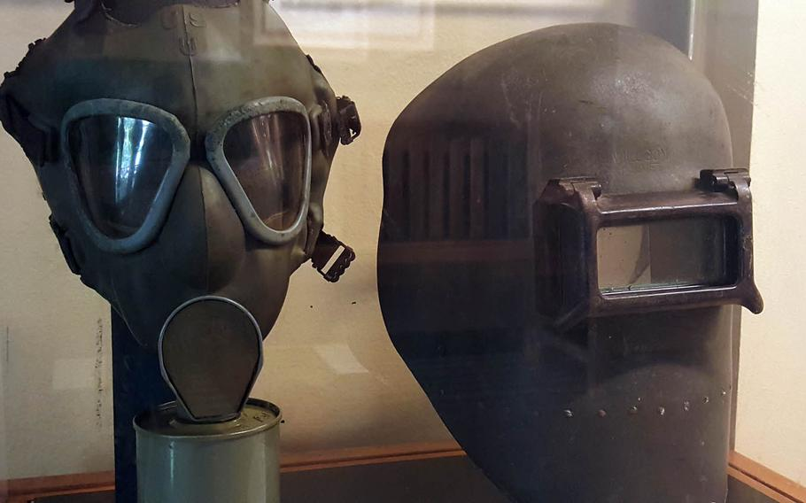 With memories of poison gas from World War I, officials distributed gas masks such as the one on the left to all Hawaiians older than 7. Of far more practical use during World War II, however, was the welding mask, right, used by workers repairing the decimated Pacific fleet and building newer ships.