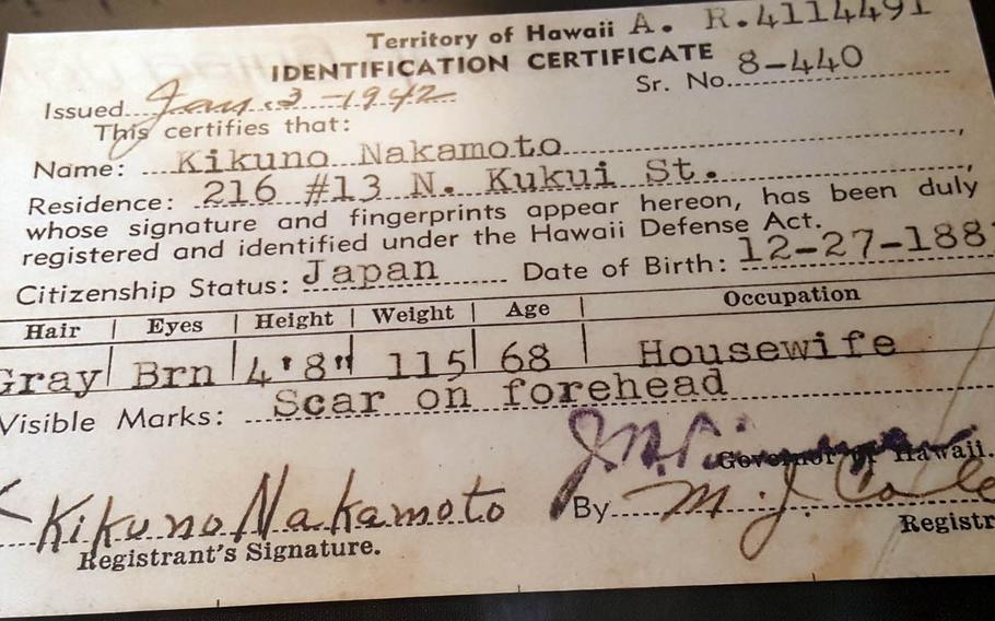 Martial law in Hawaii during World War II required everyone older than 6 to be fingerprinted and to carry at all times identification cards such as this one on display at the Bishop Museum.