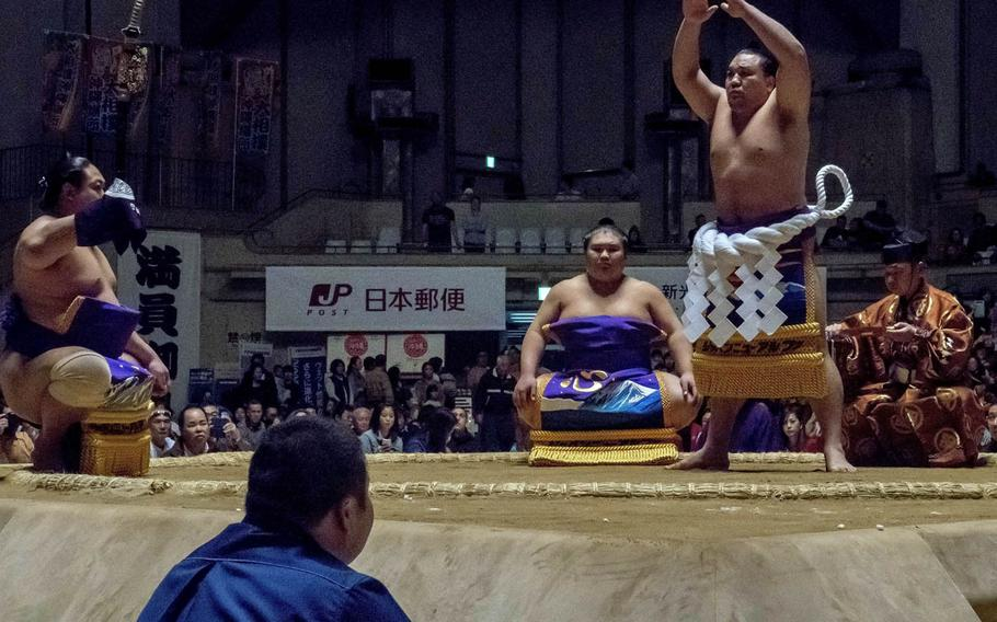 Yokozuna, the highest rank for a sumo, are identified by their white, braided-rope aprons.