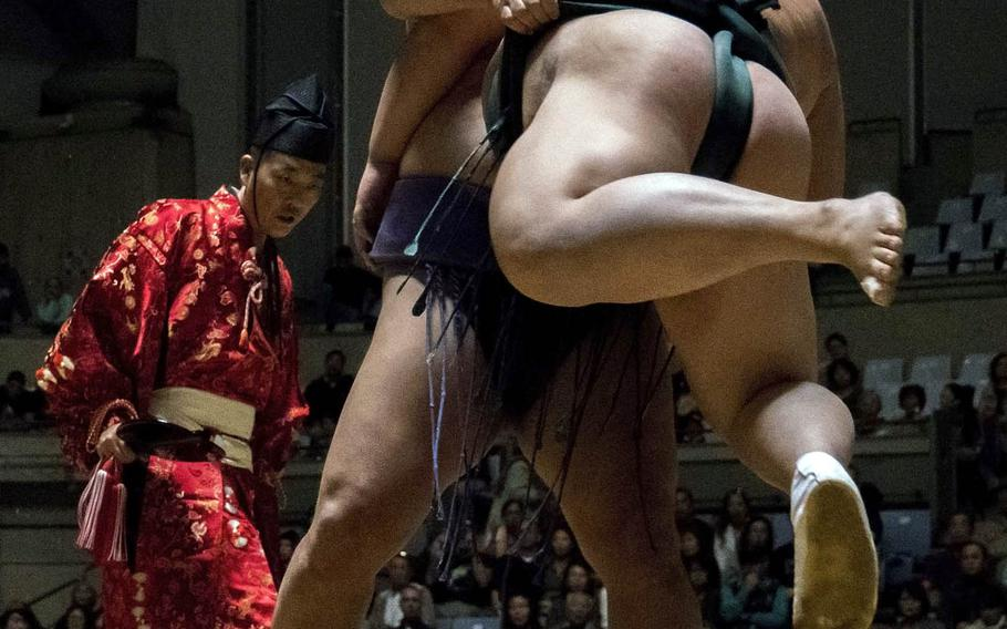 A sumo fight is lost if a wrestler steps or is forced out of the rope marking the edge of the ring or touches the ground with anything other than the soles of his feet.