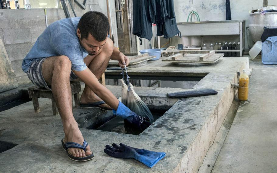 The Okinawan indigo dyeing process is slow and meticulous at Ai Kaze in Nago, Japan.