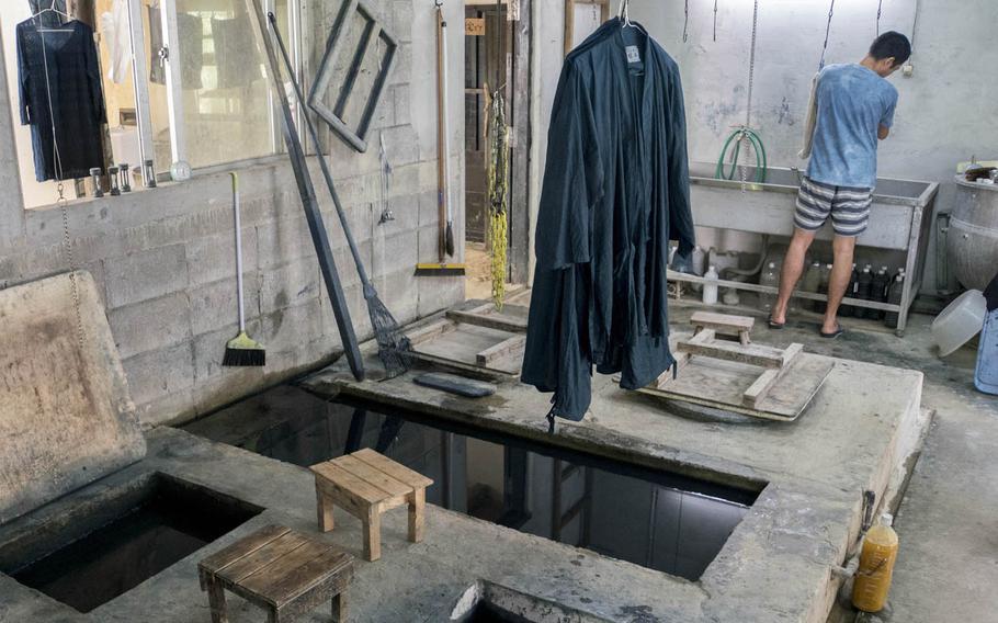 The dyeing bin Ai Kaze's indigo dyeing factory on Okinawa is nearly 5 feet deep.