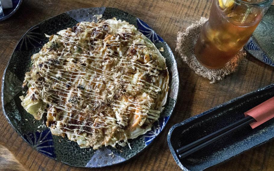 Ai Kaze's restaurant offers Okonomiyaki, a savory dish consisting of cabbage, flour, eggs and fish.