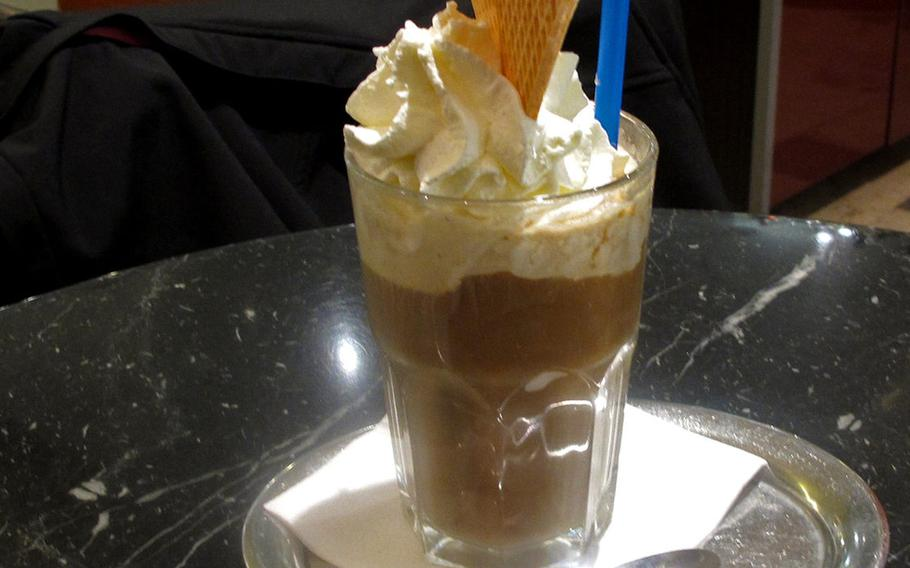 An iced coffee with whipped cream and a crispy waffle is served at Eiscafe Dolomiten in Kaiserslautern, Germany.