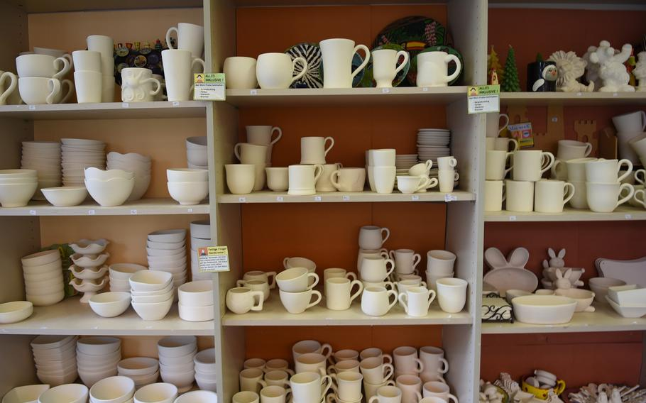 Unfinished ceramics line the shelves at Mal-Werk. Customers can pick out and paint coffee mugs, plates, bowls, piggy banks, figurines and other ceramic pieces.