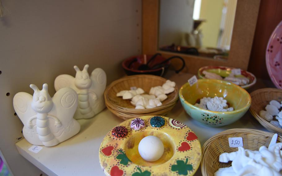 Little decorative items can be painted and attached to larger ceramic pieces at Mal-Werk in Mainz, Germany.