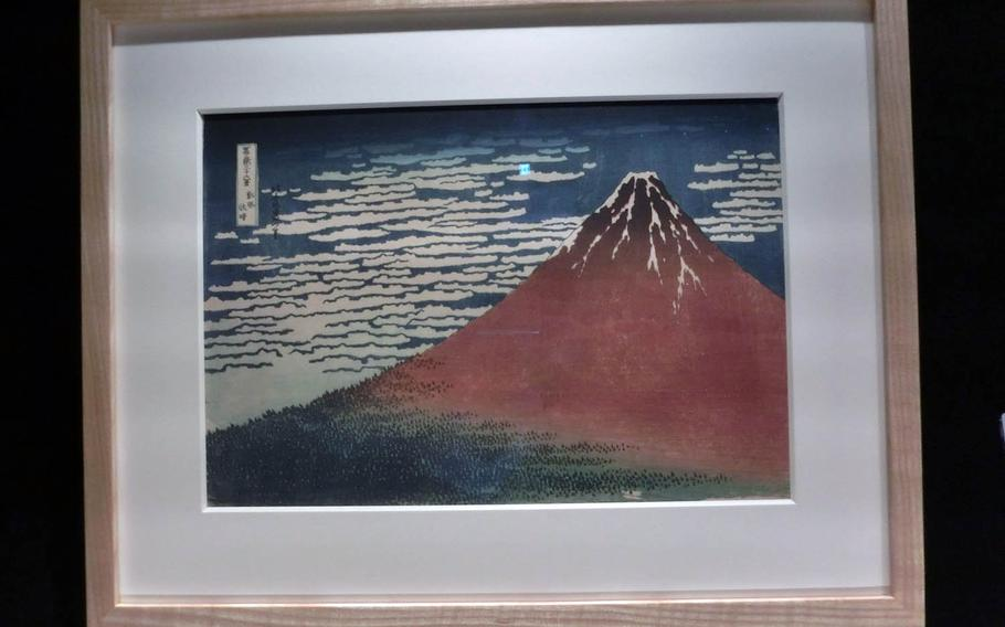 """A replica of """"South Wind, Clear Skies"""" by Katsushika Hokusai is displayed at the Sumida Hokusai Museum in Tokyo."""