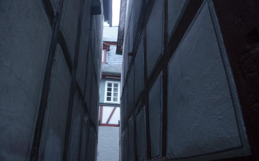 A glimpse at a narrow alley, enough for one person to pass through at a time, shows that the history of Bacharach, Germany, reaches far past the dawn of automobiles.