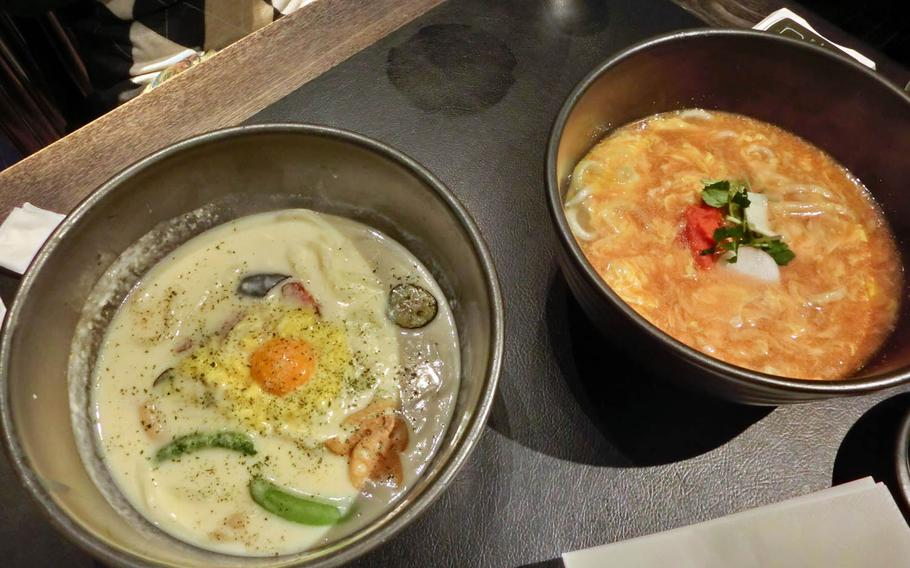 Carbonara udon, left, and mentaiko and egg ankake udon are served in large bowls at Tsuru Ton Tan in Tokyo.