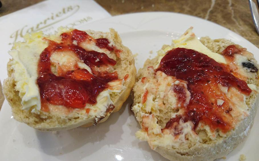 Freshly baked scones with Cornish clotted cream and strawberry jam from an order of special afternoon tea at Harriets Cafe Tearooms in Bury St. Edmunds, Suffolk, England. Afternoon tea costs 16.95-25.95 pounds per person ($21-32).