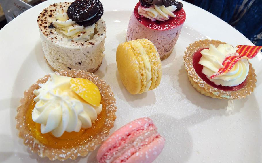 An assortment of desserts from an order of special afternoon tea at Harriets Cafe Tearooms in Bury St. Edmunds, Suffolk, England.