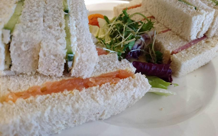 Smoked salmon, cucumber and cream cheese and Suffolk ham sandwiches from an order of special afternoon tea at Harriets Cafe Tearooms in Bury St. Edmunds, Suffolk, England. Afternoon tea ranges costs 16.95-25.95 pounds per person ($21-32).