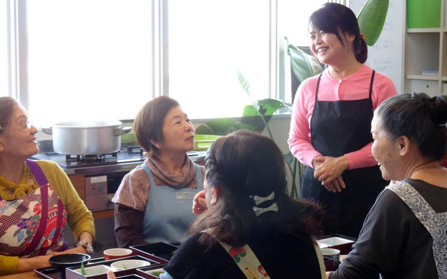 Kae Izena shares cooking tips recently at her cooking school in Okinawa, Japan. Her goal is to restore Okinawans' longevity by bringing Okinawan vegetables back into every home.