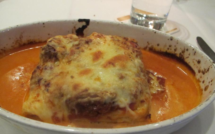 A dish of oven-baked lasagne is served at Pizzeria La Piazza. The restaurant serves high-quality Italian food at reasonable prices in downtown Kaiserslautern.