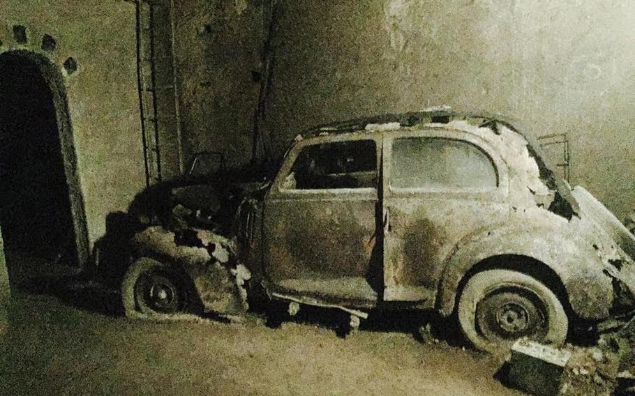 This rusty antique car sits in the shadows in the Bourbon Tunnel. It's among many that were impounded and then entombed in the tunnel when it was closed off for decades.
