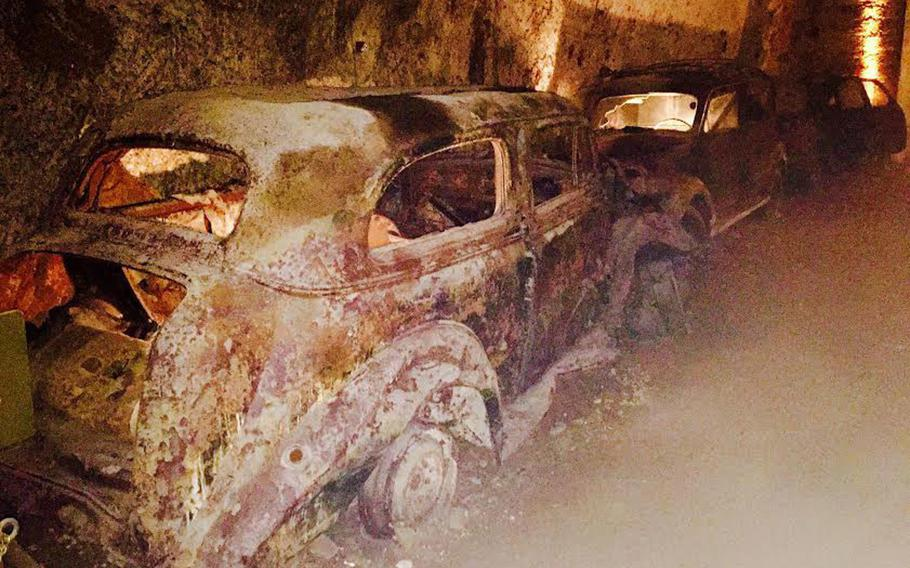 Old cars the government impounded as far back as 1950 line a stretch of the Bourbon Tunnel on March 11, 2017. They are rusty relics of a bygone era in Naples.
