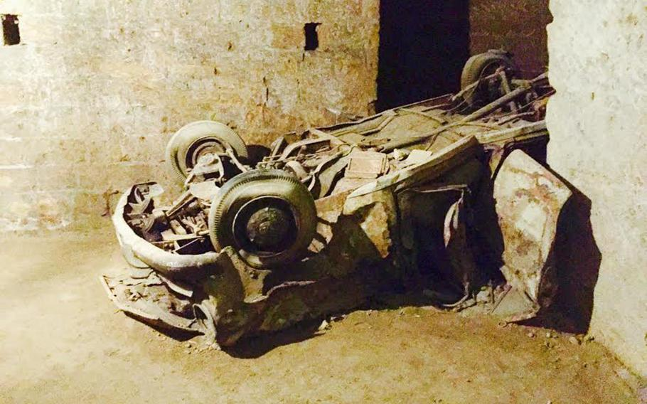 A belly-up, corroded car can be seen in the Bourbon Tunnel. The abandoned cars represent a curious chapter in the city's history, when people discarded cars the government seized.
