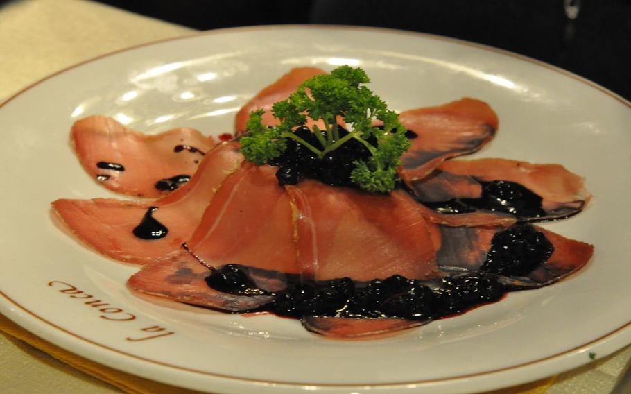 This appetizer option at La Conca featured cured ham topping a mound of rich cheese and topped with blueberries.