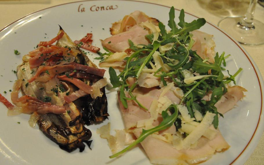 This appetizer option during a recent visit to La Conca included pork topped with rucola and shredded cheese and fried radicchio topped with bacon.