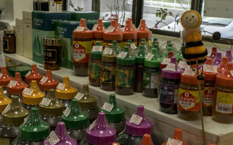 There is an English guide to help servicemembers navigate through items for sale at Kohamas Honey on Okinawa. Each bottle of honey is color coded. Orange labels indicate it 100 percent Okinawan honey.