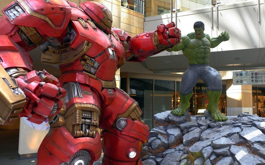 Iron Man and The Hulk battle during the Marvel Age of Heroes exhibit underway at Roppongi Hills Mori Tower in Tokyo.