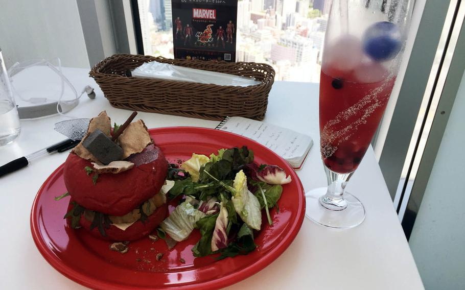 The red-bunned Mighty Thor Burger is a pork-loin sandwich served with a salad. The comic hero's hammer is featured on top.