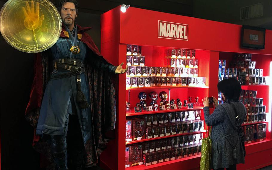 THe Hot Toys store at Marvel's Age of Heroes exhibit in Tokyo offers action figures, masks, statues and other memorabilia.