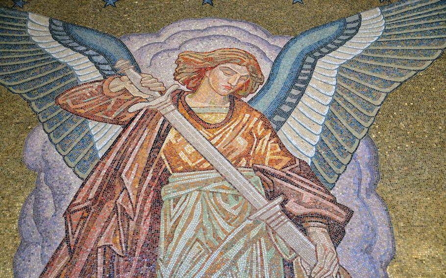 An angel sheaths his sword in a mosaic inside the chapel  at St. Mihiel American Cemetery.