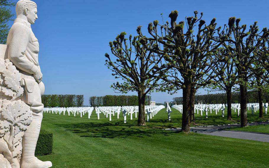 A statue of a World War I soldier overlooks the graves of the 4, 153 American war dead at St. Mihiel American Cemetery.