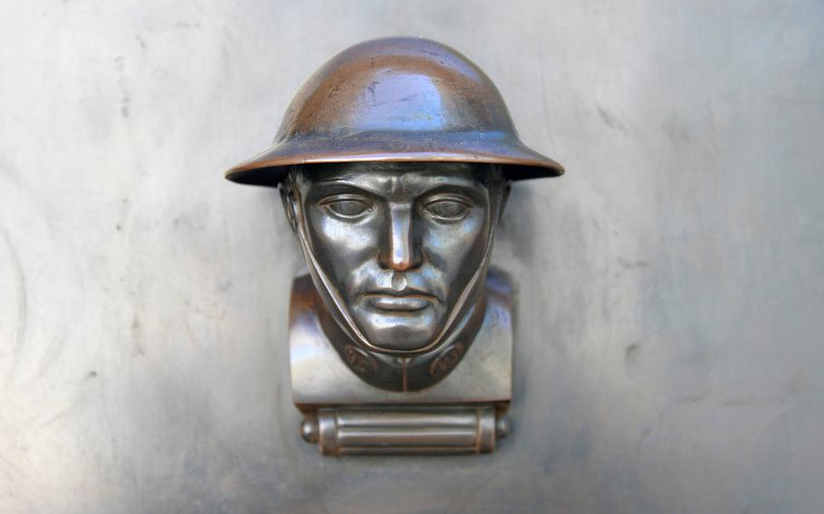The door knobs of the chapel and map room at  St. Mihiel American Cemetery are the heads of soldiers wearing the distinctive helmets of World War I.