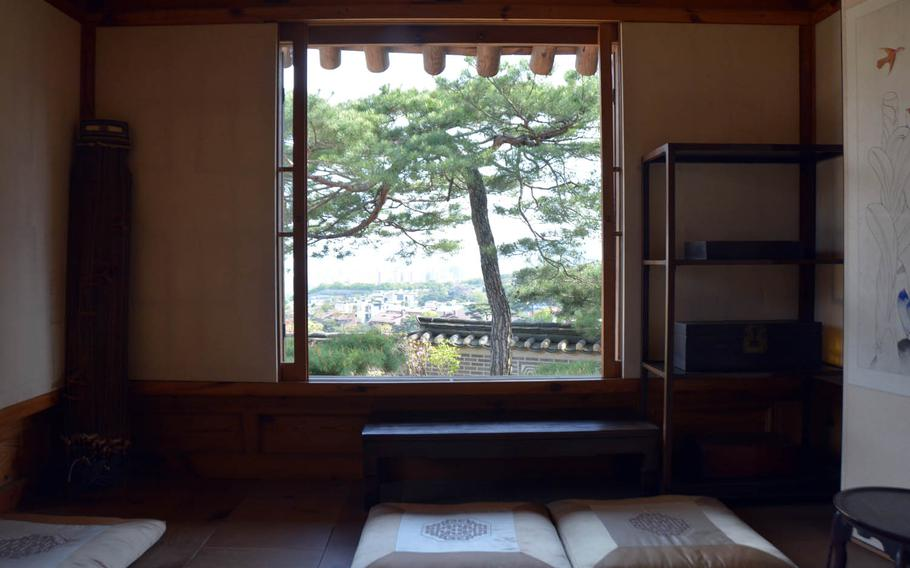 A view of Seoul as seen from inside the women's quarters in the nobleman's house at the Korea Furniture Museum.