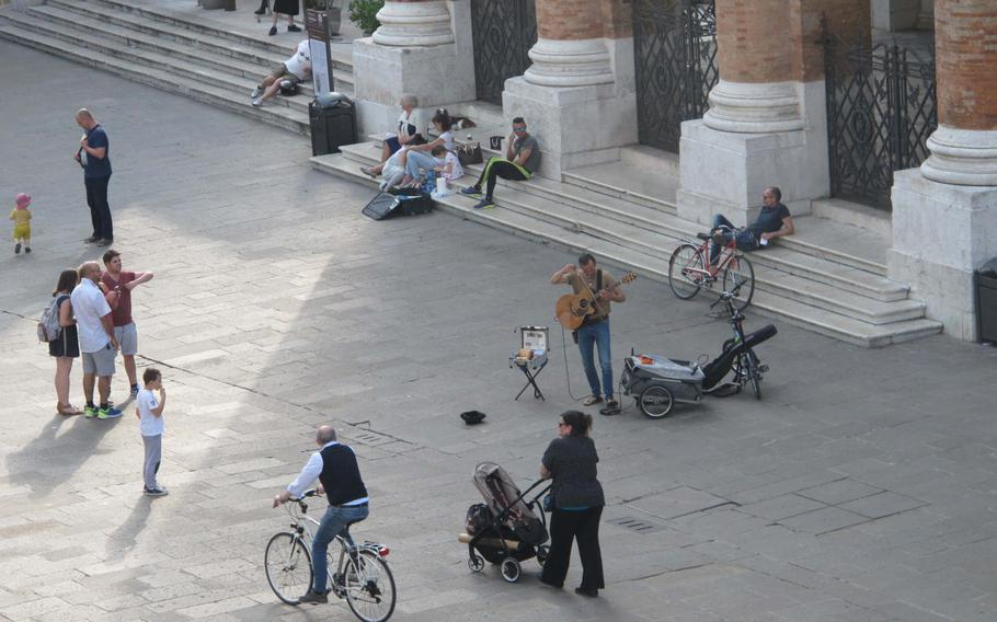 """A view from the Basilica Palladiana's terrace cocktail bar to the piazza below where a busker played an accomplished jazz guitar, launching into a lovely """"Girl from Ipanema."""""""