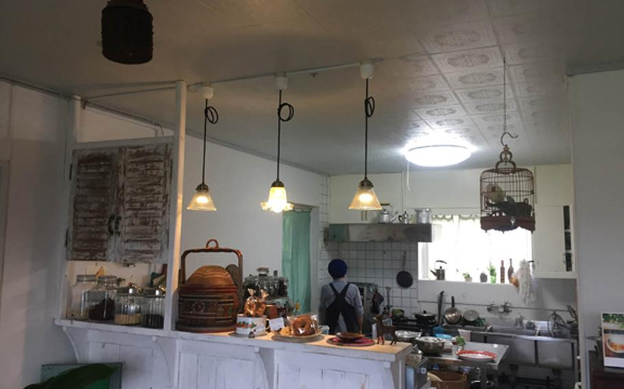 Mo cua so resembles a cozy country kitchen in the American Midwest. The eatery in Okinawa City, Japan, also doubles as an art gallery.