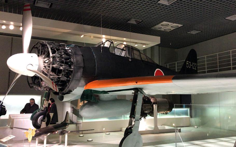 A restored Zero fighter plane flown by the Japanese Imperial Navy during World War II is displayed at the National Museum of Nature and Science in Tokyo.