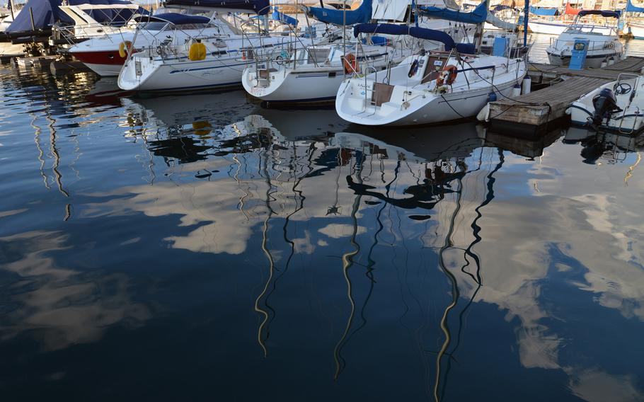 The sky is reflected in the waters of Chania, Crete's Venetian Harbor.