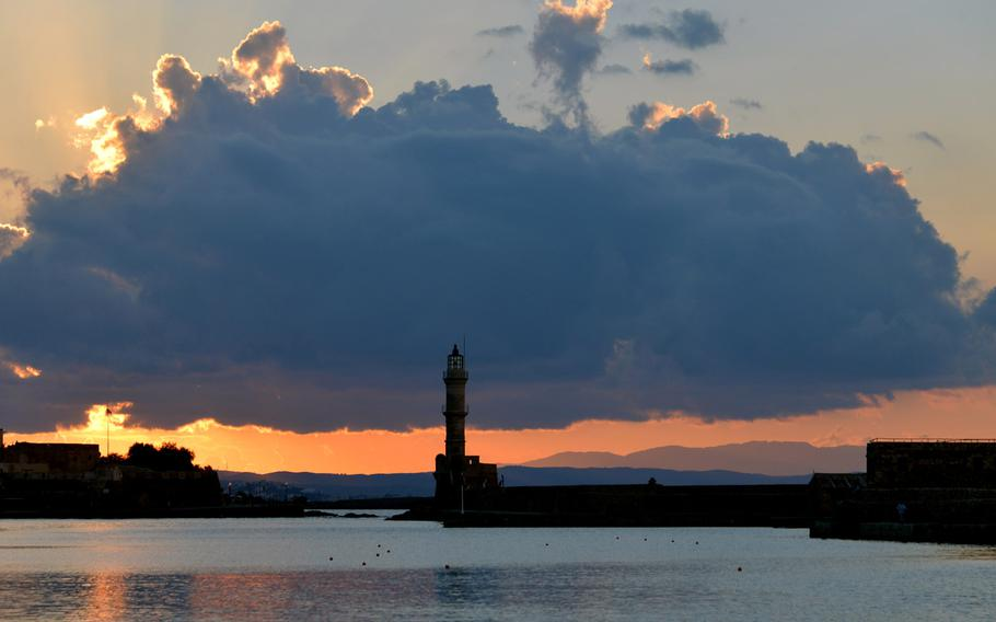 The Venetian lighthouse at the mouth of Chania, Crete's Old Port at sunset. It is sometimes called the Egyptian lighthouse because it was reconstructed by Egyptians in the 19th century.
