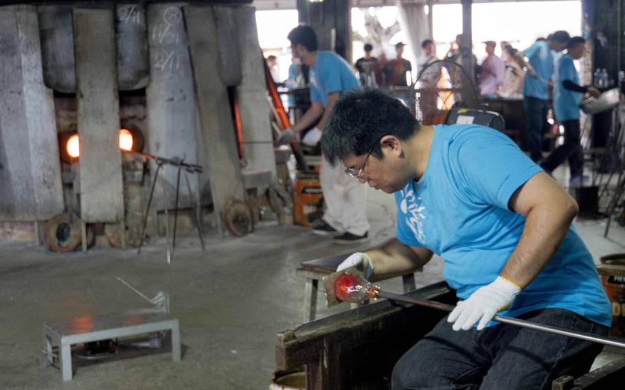 The outdoor workshop at Okinawa's Ryukyu Glass Village, next to the main building, is where all the action takes place. It can be mesmerizing to watch the artisans melt glass and form it into works of art.